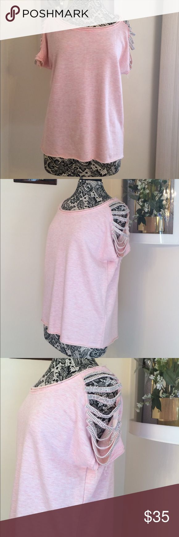 🌺🌺ITRO Rhinestone Sweatshirt Gently Used bedazzled short sleeve sweatshirt with slits in sleeves and frayed hem and boat neckline. Some minor pilling. Color is a pretty pale pink. Fabric composition 46%Polyester, 30%Cotton and 24%Rayon. ASKING PRICE OR BEST OFFER! ITRO Tops Sweatshirts & Hoodies