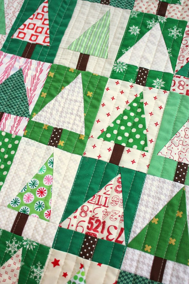 Earlier this week I shared some little patchwork tree blocks I'd been making. I loved sewing them together into this little patchwork forest mini-quilt. The method for making this blocks is quick and fun and I'm going to show you how right now! (How exciting can life get?) For my palette I chose a variety of greens in different shades and scales, to create interest and depth. I paired the greens with white-background prints and pulled in just a little bit of red. I like that it gives a hint…