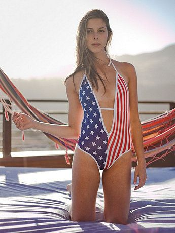 This sexy one-piece swimsuit features a plunging V-neck and open back. Peek-a-boo strap in front ties in back.