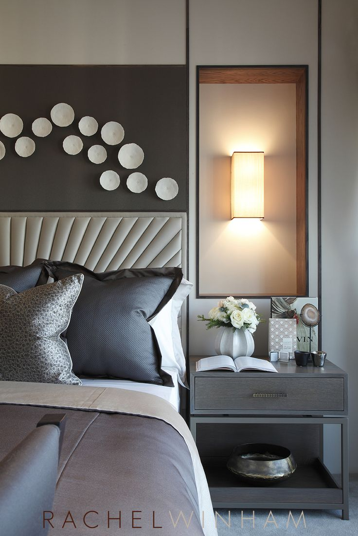 Luxurious bedroom design by Rachel Winham Interior Design, featuring a starburst headboard, inset wall lighting and porcelain wall sculptures.