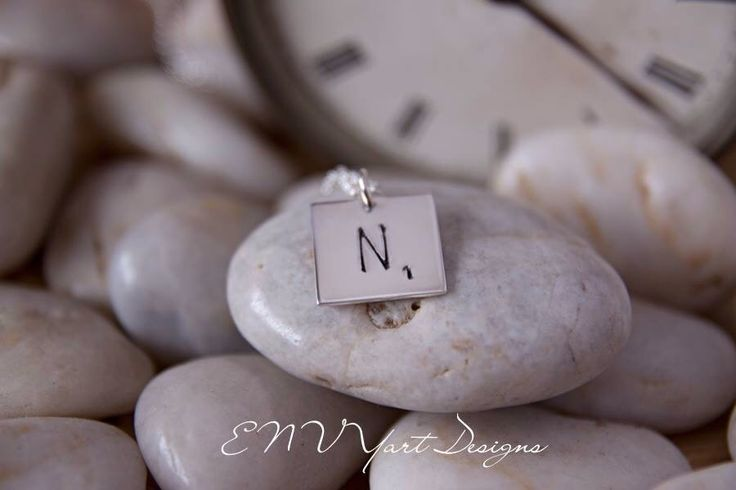 Scrabble inspired, sterling silver tile pendant.  Hand stamped with letter and game piece value.  www.fb.com/envyartdesigns   #scrabbletile #sterlingsilver #handstampedjewellery #envyartdesigns