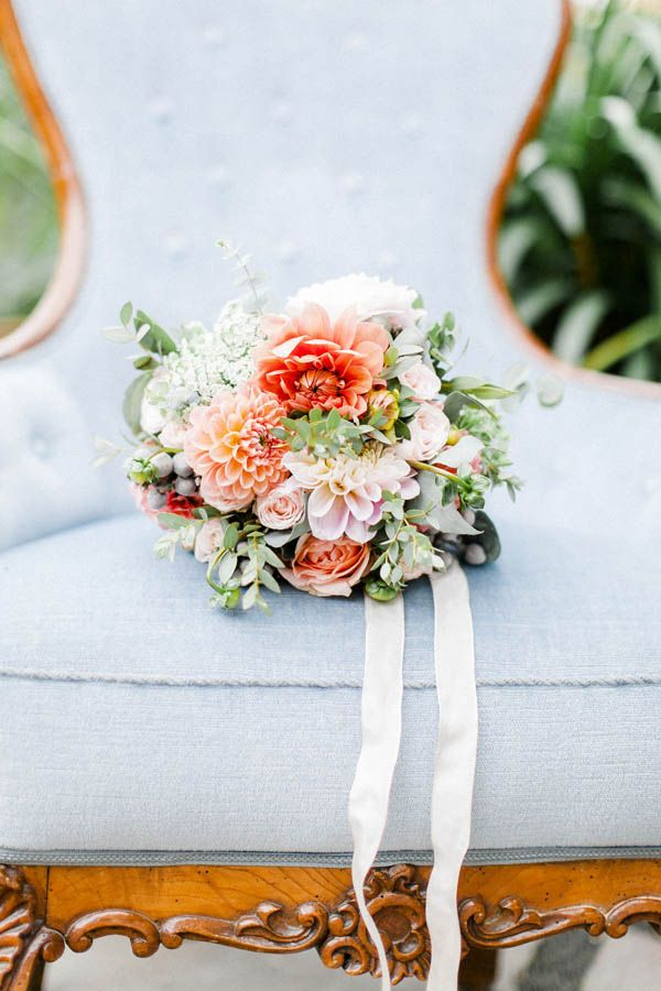 6391c0c8f972 beautiful bridal bouquet in coral and apricot tied with a white silk ribbon  made of dahlias #weddingcolorcoral #livingcoral #weddingtrend #coraltrend  ...