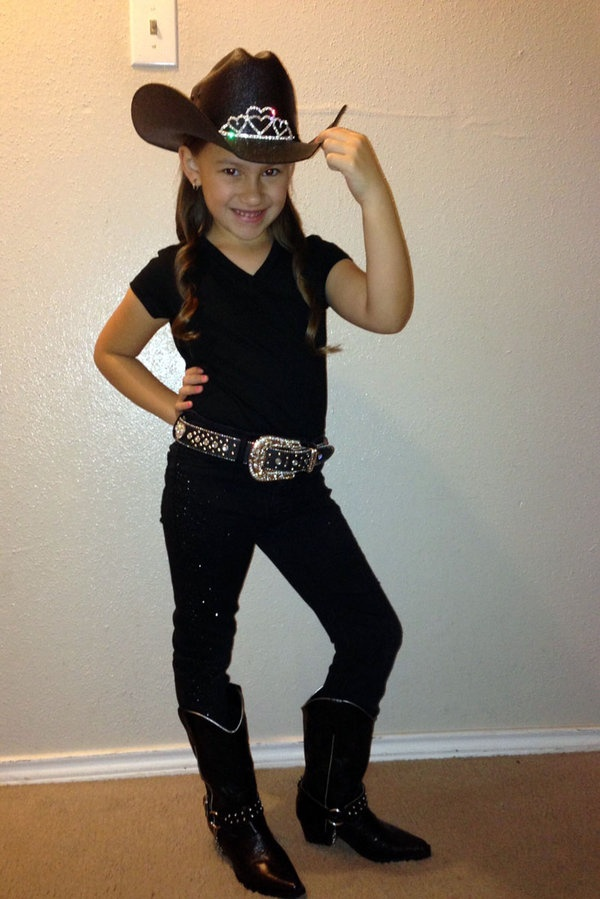 """The 2013 Houston Livestock Show and Rodeo is here, and that means Friday is """"Go Texan Day!"""" Thousands of kids (and their parents) left the house dressed to impress in their best western wear."""