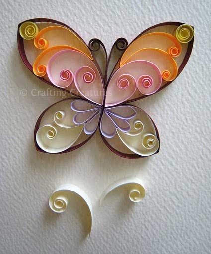 mariposa quilling - un montón de grandes ideas quilling / papercraft de este blog - Criaturas Crafting