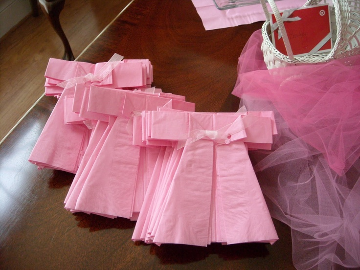 Napkins for baby shower.  These napkins are so simple to fold and cut. You just re-fold the napkin to where the open edges are on the front. You then cut a little slit on each side to make the sleeves and fold the bottom sides back at an angle. Then you fold the front edges back to make a collar. Then use a hole punch to punch through both layers and tie a piece of ribbon through for the finishing touch.