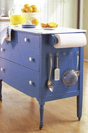 An old dresser + paint + a top of your choice + hooks on the side + paper towel roll = A KITCHEN ISLAND!!.