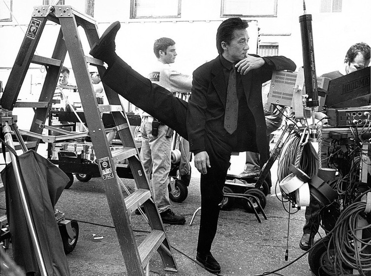 Jackie Chan. Stretching. Probably during the set of Rush Hour. ^_^