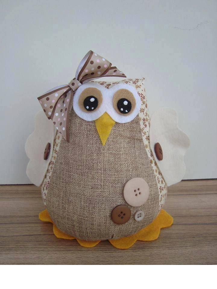 Love this stuffed owl. The fabrics and shape are different than you usually see. Aguantaportes