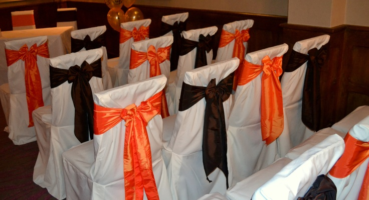 Alternating Orange and Chocolate Satin Bows on White Chair Covers