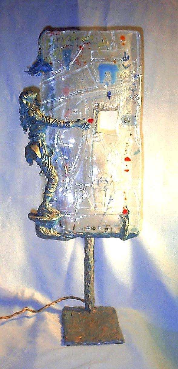 """SCULTURA LUMINOSA """"NINFA DEL BOSCO"""" Scultura luminosa realizzata in metallo, resina e pasta di vetro.  Dimensioni: larghezza cm.25, altezza cm. 55,  profondità  cm.30"""
