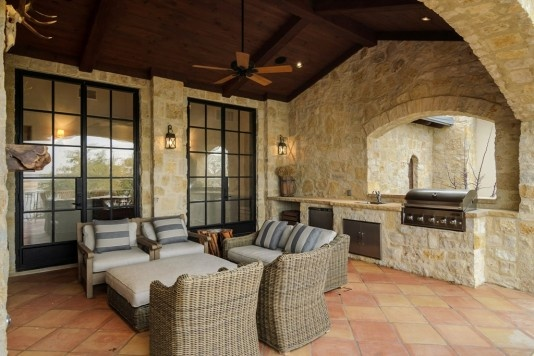 Outdoor entertaining area with kitchen & fireplace.