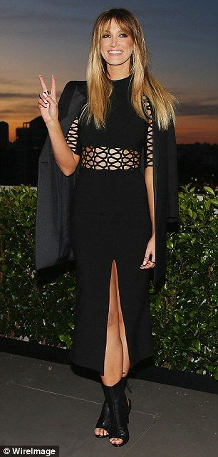 Racy: Celebrity coach Delta Goodrem also showed off a portion of her trim pins in her revealing outfit