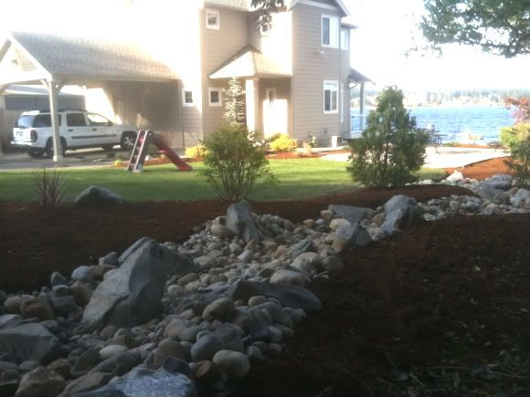 Top 40 ideas about dry river beds on pinterest gardens for Nw construction