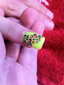 Yellow Acrylics with Free hand leopard print nail art