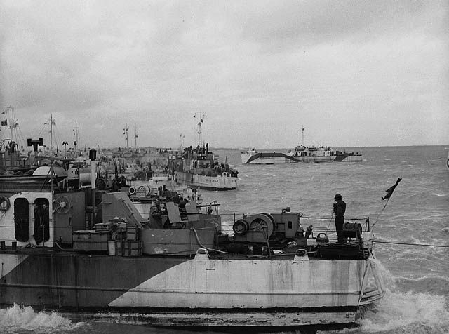 Looking west along 'Nan White' JUNO Beach showing LCI(L)s of the 2nd and 3rd (262nd and 264th RN) Flotillas landing personnel of the 9th Canadian Infantry Brigade