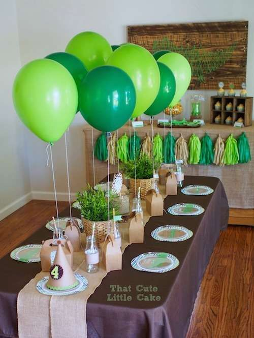 Green and brown table at a crocodile birthday party! See more party ideas at CatchMyParty.com!