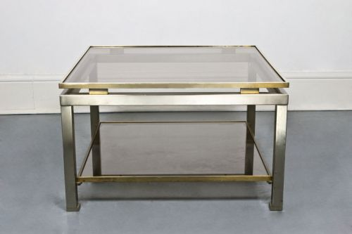 Brass framed and smoked glass two tiered table by Guy Lefevre