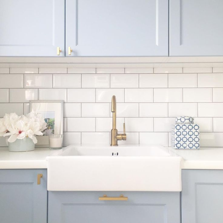 Perfect pale blue and brass laundry room