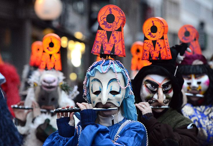 """Carnival revelers move through the city making music at the """"Morgestraich"""" (""""morning prank"""") celebrations in Basel. The """"Morgestraich"""" marks the beginning of the carnival of Basel lasting 72 hours, which attracts thousands of spectators from Switzerland as well as from Germany, France and Luxembourg."""