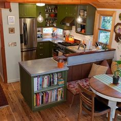 This is not in a yurt, but I like how the kitchen is compact yet with plenty of workspace and open to the house.