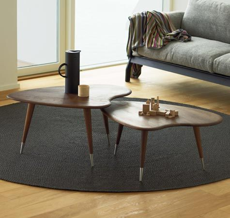 Danish retro walnut coffee tables like the idea of two or three even smaller tables that you can move around the room when needed.. also like the round edges