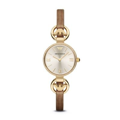 Classic Watch This petite, jewelry-inspired addition to the Emporio Armani ladies' collection features branded hardware, a champagne sunray dial and dark brown lizard-embossed leather for a truly chic aesthetic.