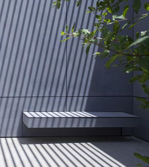Bench integrated in facade. Jacobs Yaniv architects. EQUITONE facade materials. equitone.com
