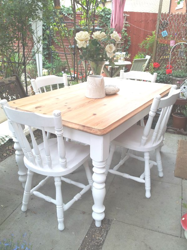 Plain old Pine Table & 4 chairs, stripped right back and beeswaxed, then base & chairs painted in Laura Ashley Pearl, distressed and varnished, totally transformed!
