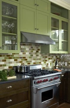 Excellent coordination between the upper green, backsplash, and lower green...  Capitol Hill Residence - traditional - kitchen - seattle - by Patricia Brennan Architects