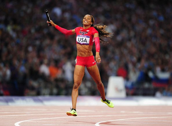 Sanya Richards-Ross of the United States celebrates as she crosses the finish line to win gold in the Women's 4 x 400m Relay Final