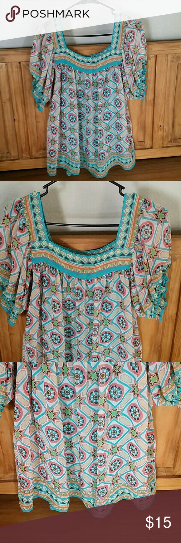 Gorgeous multicolored blouse This top is so comfortable and pretty.  Turquoise, peach, green, yellow, pink somewhat of an Aztec or tribal print.  Has a coordinating blue cami.  Fabric is super soft and flowy. Nicole by Nicole Miller Tops Blouses