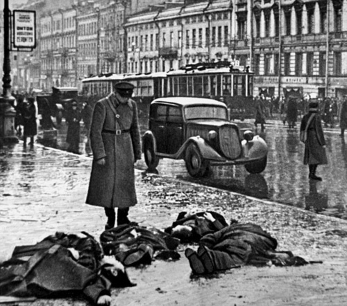 A Red Army soldier stares upon the dead during The Siege of Leningrad, 1941.