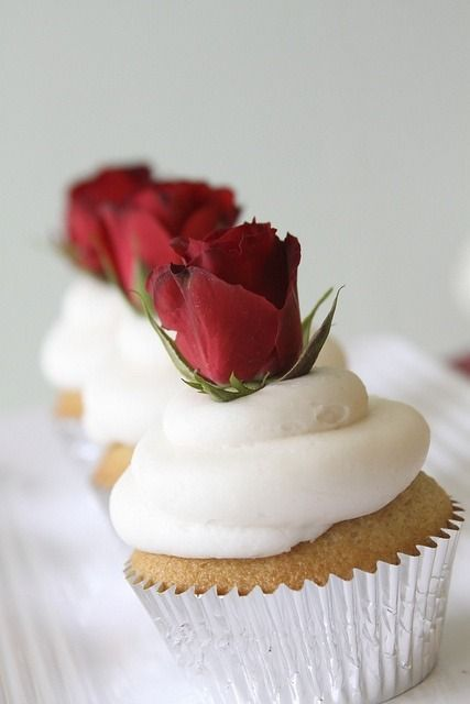 """Spray roses as cupcake decorations. I LOVE this. Not red roses, but white or pastel on """"Arizona Lazy"""" cupcakes would be beautiful!"""