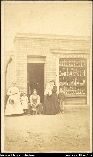nla.pic-vn4604970  Merlin, Beaufoy, ca. 1830-1873  A family in front of W. Branscombe store with window display of lamps, Hill End, New South Wales, ca. 1873 [picture]  1872 or 1873. 1 photograph on carte-de-visite mount : sepia toned ; 10.4 x 6.3 cm.  Part of B.O. Holtermann archive of Merlin and Bayliss photographic prints of New South Wales and Victoria [picture]. between 1872 and 1888.