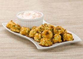 Cheesy Cauliflower Tots - Serve these to your family as a side with dinner. The taste is so similar to traditional tater tots, they may not realize it's cauliflower that they're eating!