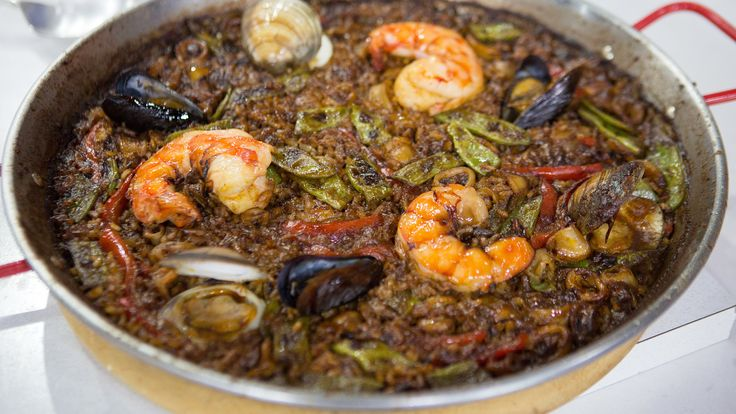 Host a Spanish dinner party with flavorful seafood paella and fruity sparkling sangria with these recipes from chef Omar Allibhoy.