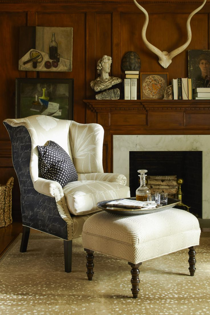 Take a seat and relax by the fire. Put your feet up on the James Ottoman, which complements the patterns and colors of the fabrics used on the Thorn Tail Chair. #sitting_room  Image: calicocorners.com