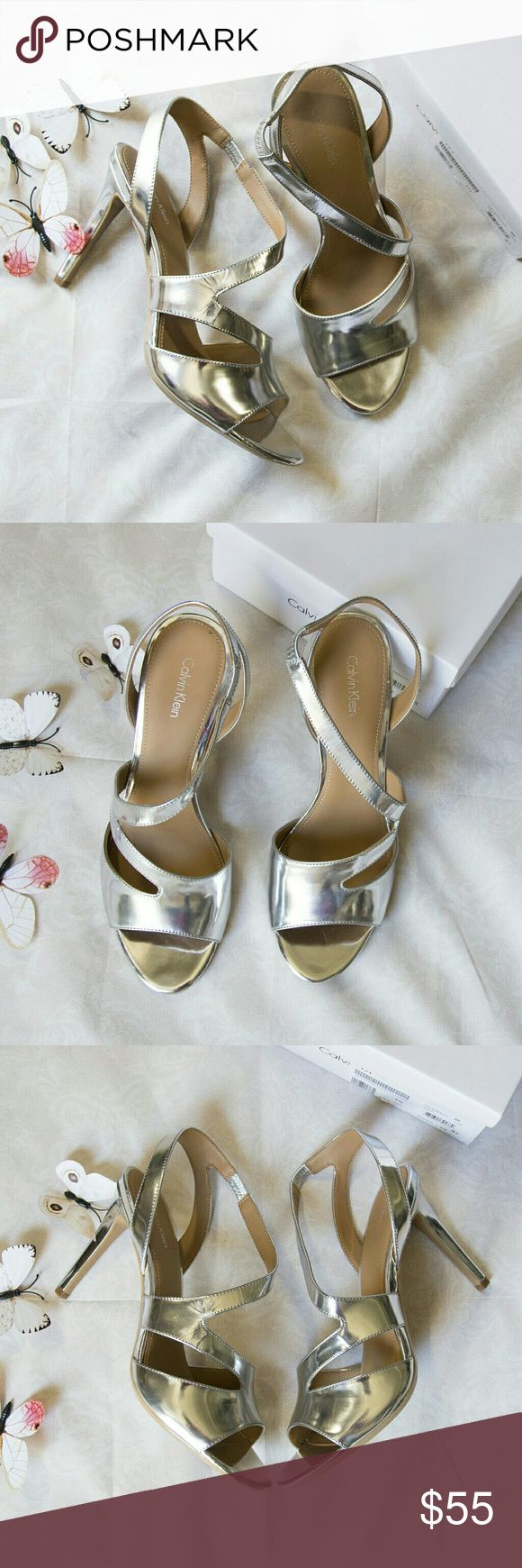 "New CALVIN KLEIN metallic silver sandal heels New in box CALVIN KLEIN sz 10M metallic silver sandal heels MSRP $109  size: 10M color: silver  - Open toe - Cutout detail - Asymmetrical vamp strap - Slip-on - Approx. 4.75"" heel - Imported Calvin Klein Shoes Heels"