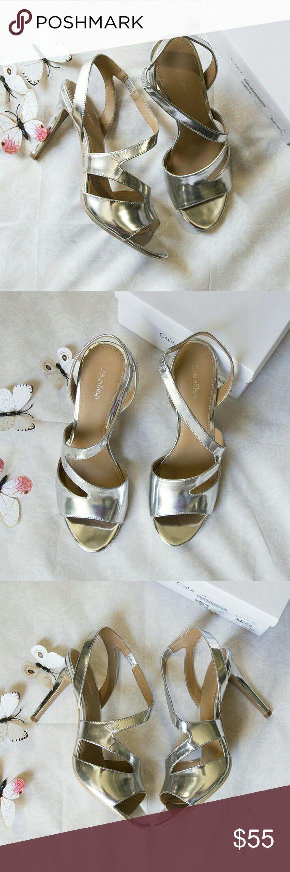 "New CALVIN KLEIN metallic silver sandal heels New in box CALVIN KLEIN sz 10M metallic silver sandal heels MSRP $109  size: 10M color: silver  - Open toe - Cutout detail - Asymmetrical vamp strap - Slip-on - Approx. 4.75"" heel - Imported Calvin Klein Shoes Heels"