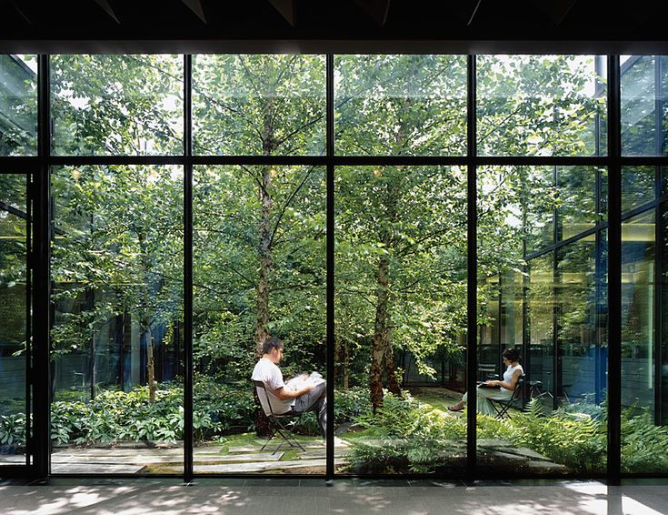 """Fashion designer Elie Tahari hired MVVA to add a soothing landscape to a windowless suburban """"box"""" he was renovating to relocate 300 warehouse and accounting staff."""