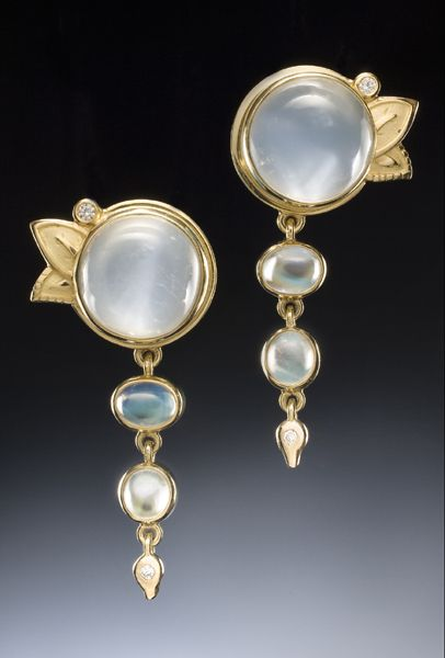 18k gold earrings set with fine white moonstones, rainbow moonstones, and diamonds by Conni Mainne