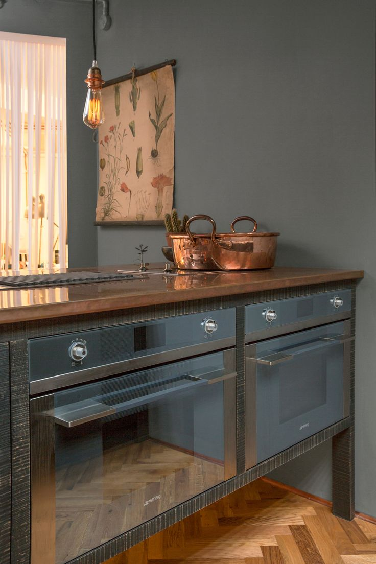 A cool copper worktop and integrated ovens in the new Sebastian Cox Island by deVOL