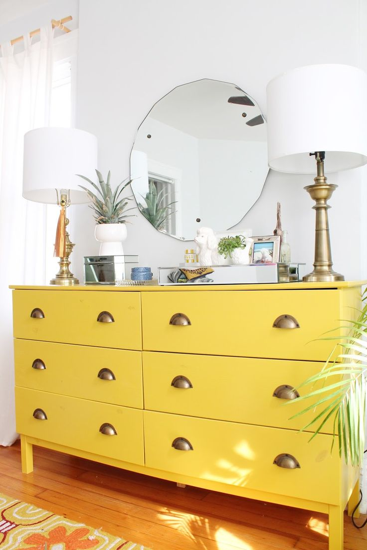 Create a luxe lacquer dresser with an easy Ikea hack and brass drawer pulls.
