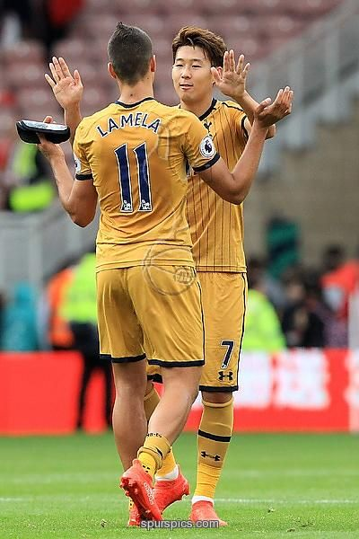 Son Heung-Min (R) celebrates with Tottenham Hotspur's Argentinian midfielder Erik Lamela following the English Premier League football match between Middlesbrough and Tottenham Hotspur at Riverside Stadium in Middlesbrough.