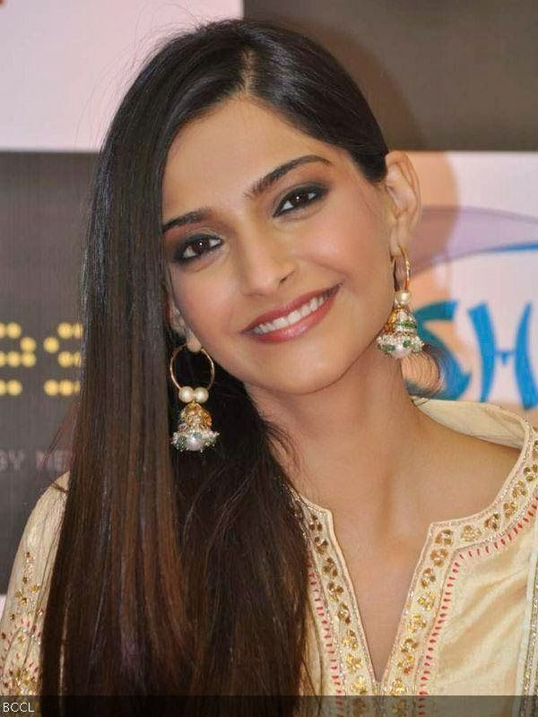 Sonam looks amazing in these gold pearl jhumkas