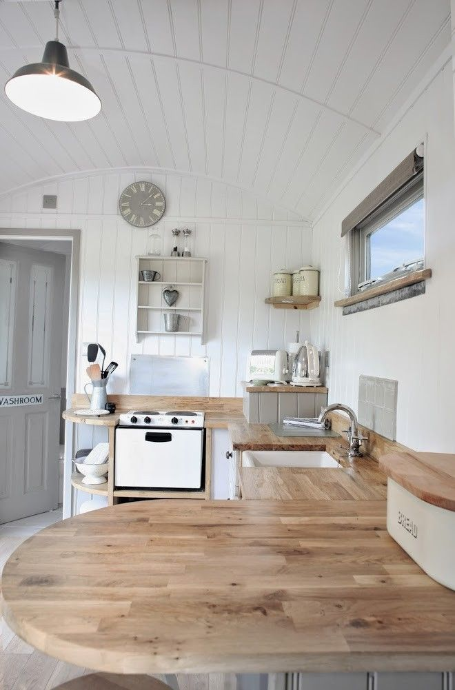 Shepherd's Hut Retreat, Somerset, UK | Remodelista Love the panelling, and the wood coming up slightly on the wall instead of panneling / splashback. Could work.