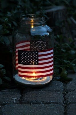 Easy Patriotic Hurricane ~ Each hurricane is made using one large pickle jar and two mini flags
