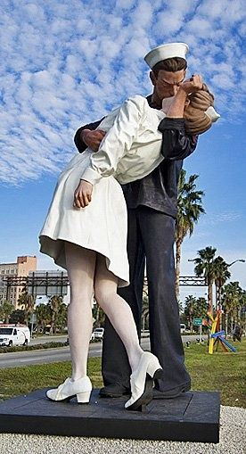 """Unconditional Surrender"" statue on Sarasota, Florida's bayfront ... from the V-J Day in Times Square photograph by Alfred Eisenstaedt that portrays George Mendosa, an American sailor, kissing Greta Friedman, a woman in a white dress on Victory over Japan Day (V-J Day) in Times Square, New York City, on August 14, 1945. The photograph, which was published a week later in Life magazine, is known under various titles, such as V-J Day in Times Square, V-Day, and The Kiss."