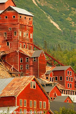 Kennecott Mill in the Wrangell-St Elias National Park, Alaska. Incredible pin!! With all the fab old red painted wood, reminds me of Christmas (imagine when there's snow on the ground!!!) 12/23/12