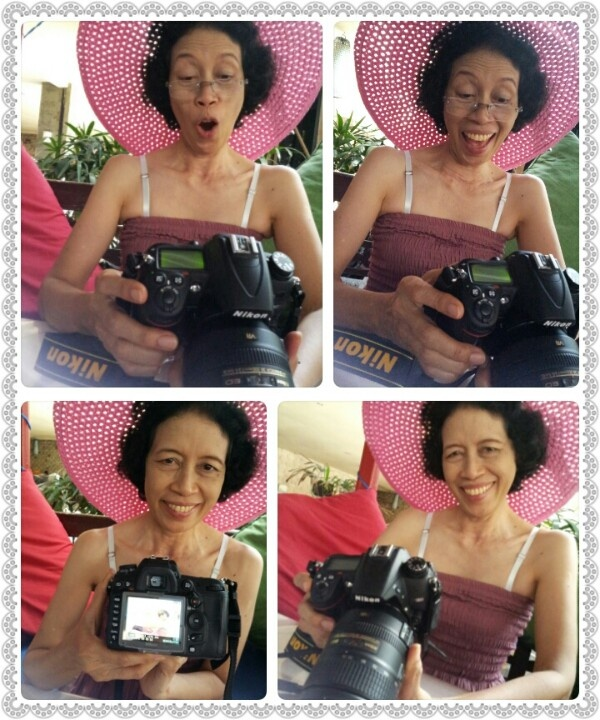 My mom previewing the photos of herself taken by me. Kuta Beach, Bali.